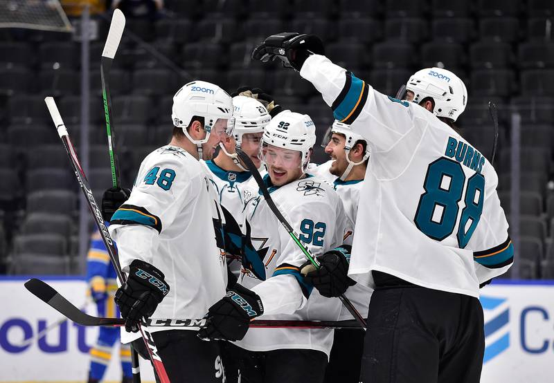 Feb 20, 2021; St. Louis, Missouri, USA;  San Jose Sharks left wing Rudolfs Balcers (92) is congratulated by teammates after scoring during the second period against the St. Louis Blues at Enterprise Center. Mandatory Credit: Jeff Curry-USA TODAY Sports