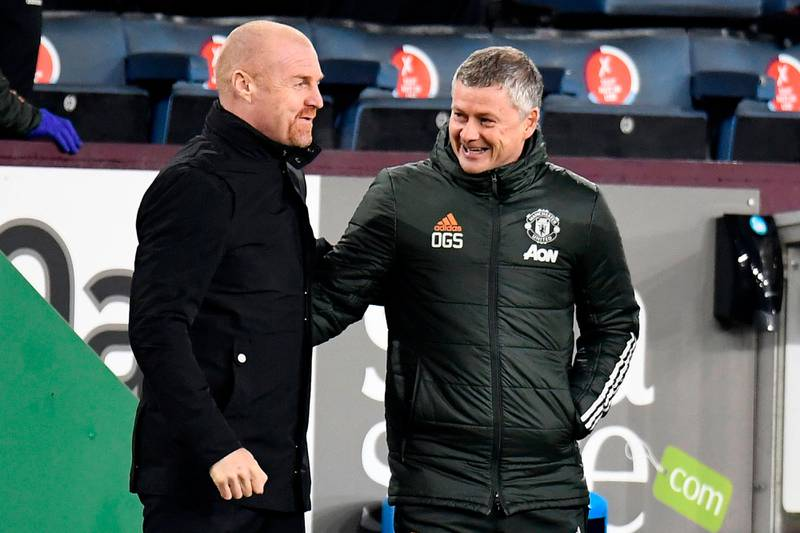 Burnley's English manager Sean Dyche (L) greets Manchester United's Norwegian manager Ole Gunnar Solskjaer during the English Premier League football match between Burnley and Manchester United at Turf Moor in Burnley, north west England on January 12, 2021. (Photo by PETER POWELL / POOL / AFP) / RESTRICTED TO EDITORIAL USE. No use with unauthorized audio, video, data, fixture lists, club/league logos or 'live' services. Online in-match use limited to 120 images. An additional 40 images may be used in extra time. No video emulation. Social media in-match use limited to 120 images. An additional 40 images may be used in extra time. No use in betting publications, games or single club/league/player publications. /
