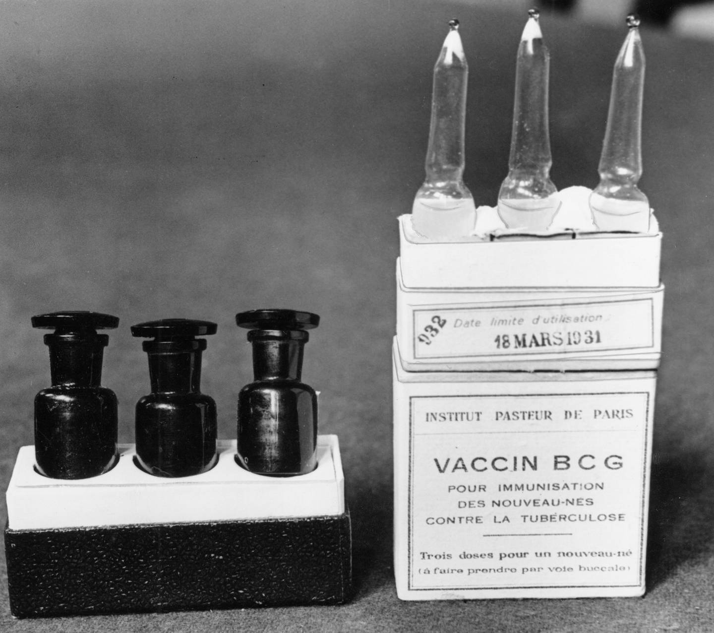 FILE - This March 1931 file photo shows ampules of the BCG vaccine against tuberculosis in a laboratory at the Institute Pasteur in Paris, France. Dec. 2, 1947 file photo. Scientists are dusting off some decades-old vaccines against TB and polio to see if they could provide stopgap protection against COVID-19 until a more precise shot arrives.  (AP Photo/Alfred Eisenstaedt)