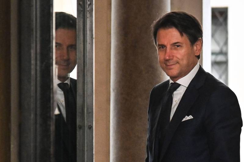 Italy?s Prime Minister Giuseppe Conte arrives to attend a meeting at the Senate, after he was given by the Italian president a mandate to form a new government, on August 29, 2019 in Rome. - The anti-establishment Five Star Movement (M5S) and the centre-left Democratic Party (PD), once bitter foes, agreed on August 28 to govern in coalition following the collapse of Italy's populist government earlier this month. (Photo by Andreas SOLARO / AFP)