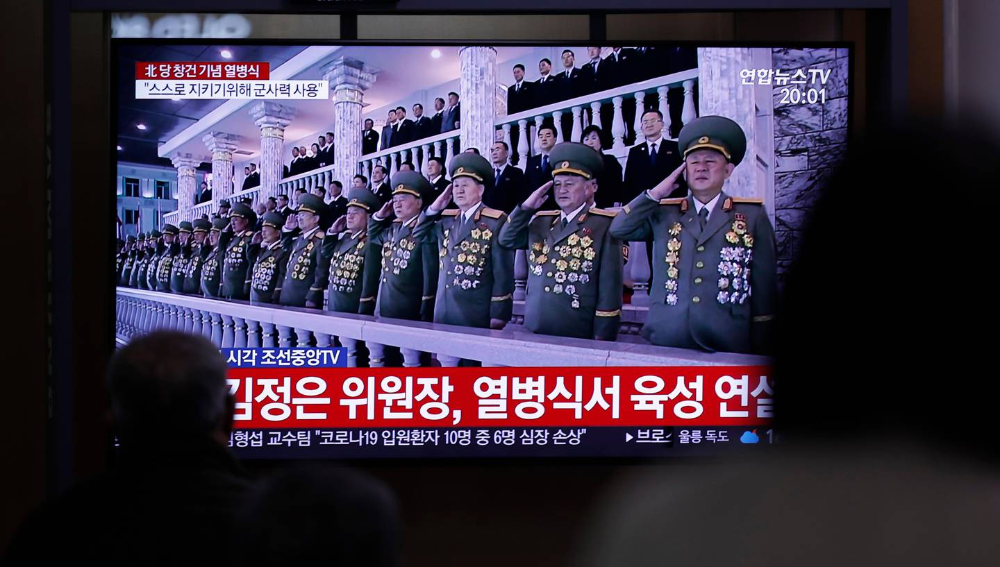 """People watch a TV screen during a news program reporting about the ceremony to mark the 75th founding anniversary of the North Korea's ruling Workers' party, at the Seoul Railway Station in Seoul, South Korea, Saturday, Oct. 10, 2020. A part of letters read """"North Korean leader Kim Jong Un speaks at a military parade."""" (AP Photo/Lee Jin-man)"""