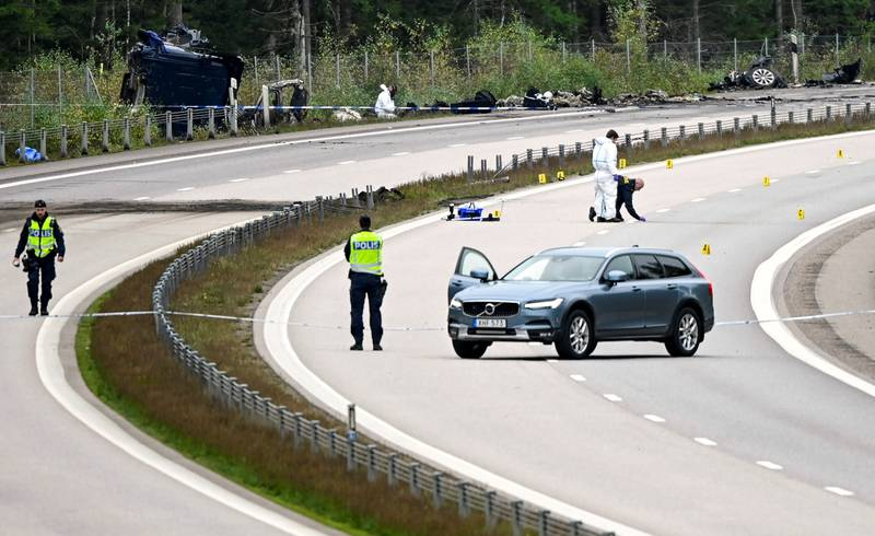 Forensic technicians work at the scene after a traffic accident between a car and a lorry,which killed three people including the Swedish artist Lars Vilks, outside the town of Markaryd in Sweden, October 4, 2021. TT News Agency/Johan Nilsson/via REUTERS  ATTENTION EDITORS - THIS IMAGE WAS PROVIDED BY A THIRD PARTY. SWEDEN OUT. NO COMMERCIAL OR EDITORIAL SALES IN SWEDEN.
