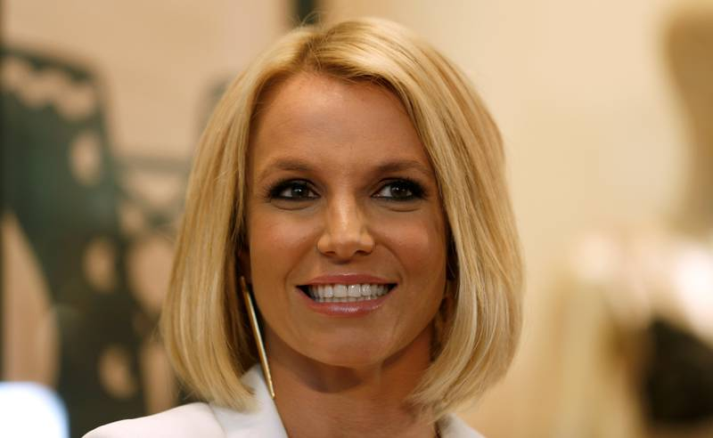 FILE PHOTO: Singer Britney Spears smiles during the launch of her lingerie collection 'The Intimate Britney Spears Spring/Summer 2015', at a shopping mall in Oberhausen September 25, 2014. REUTERS/Ina Fassbender/File Photo