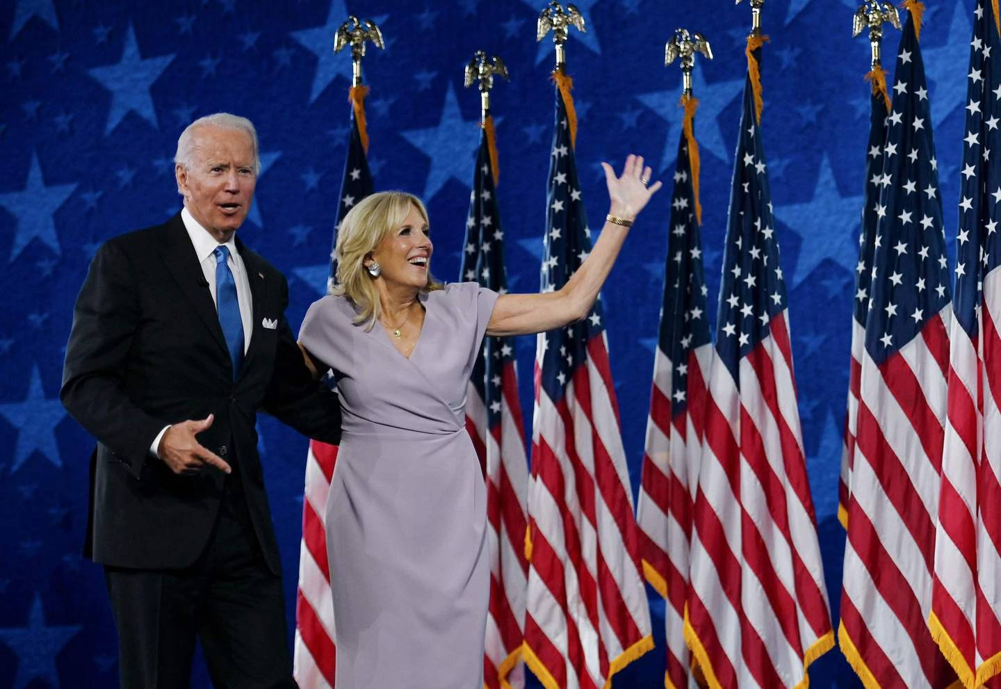 (FILES) In this file photo taken on August 20, 2020 Jill Biden and husband former vice-president and Democratic presidential nominee Joe Biden stand on stage at the Chase Center in Wilmington, Delaware, at the conclusion of the Democratic National Convention, held virtually amid the novel coronavirus pandemic. - He has suffered profound personal tragedy and seen his earlier political ambitions thwarted, but veteran Democrat Joe Biden hopes his pledge to unify Americans will deliver him the presidency after nearly half a century in Washington (Photo by Olivier DOULIERY / AFP)