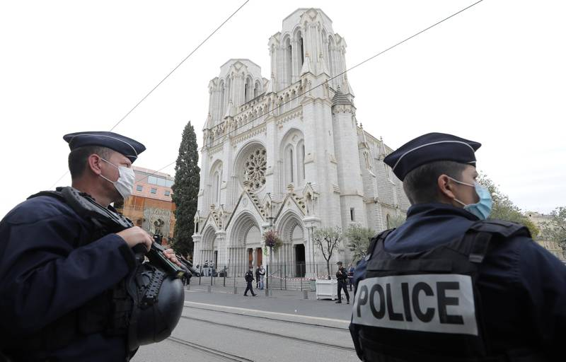 Police officers stand guard at the scene of a reported knife attack at Notre Dame church in Nice, France, October 29, 2020. REUTERS/Eric Gaillard/Pool